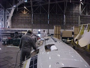 Aircraft skin from the left side removed for making a template for the replacement skin