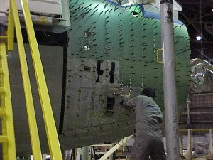 A view of the copilot's side with the replacement skin being attached