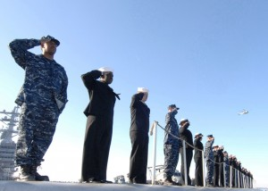 Sailors man the rails on the USS Eisenhower (CVN-69)