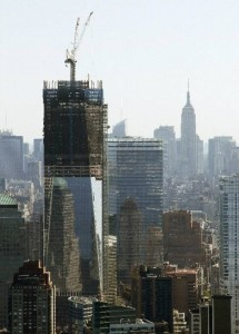 One World Trade Center under construction with Empire State Building in background