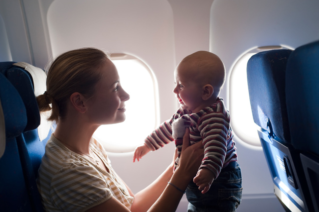Mother Holds Baby On an Airplane
